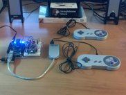 A BeagleSNES v0.4 system running on a BeagleBone Black board with two USB gamepads via an external USB hub