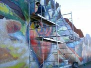Cleaning a section of the Barrio Anita tile mural in Tucson.