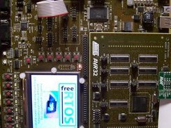 LCD displaying the AVR32 and FreeRTOS.org logos