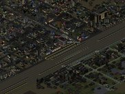A nighttime view of a suburb split by a large rail line
