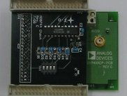 An AD9744 DAC eval. board and its chain daughterboard.